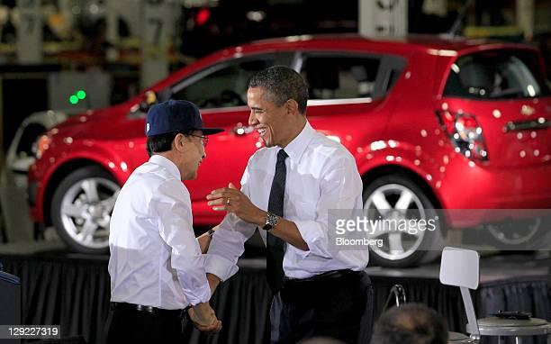 Lee Myung-bak, president of South Korea, left, shakes hands with U.S. President Barack Obama after speaking at the General Motors Co. Orion Assembly...