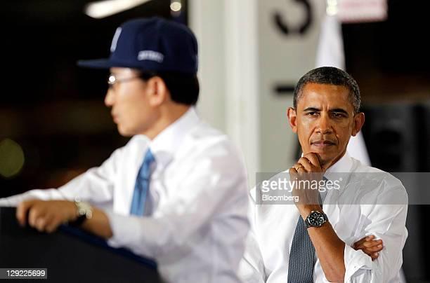 Lee Myung-bak, president of South Korea, left, speaks while U.S. President Barack Obama looks on at the General Motors Co. Orion Assembly Plant in...