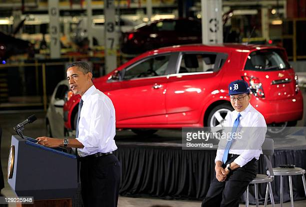 Lee Myung-bak, president of South Korea, right, looks on while U.S. President Barack Obama speaks at the General Motors Co. Orion Assembly Plant in...