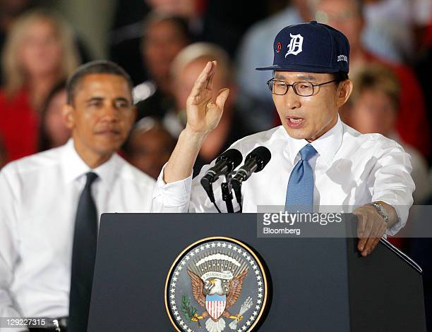 Lee Myung-bak, president of South Korea, right, speaks while U.S. President Barack Obama looks on at the General Motors Co. Orion Assembly Plant in...
