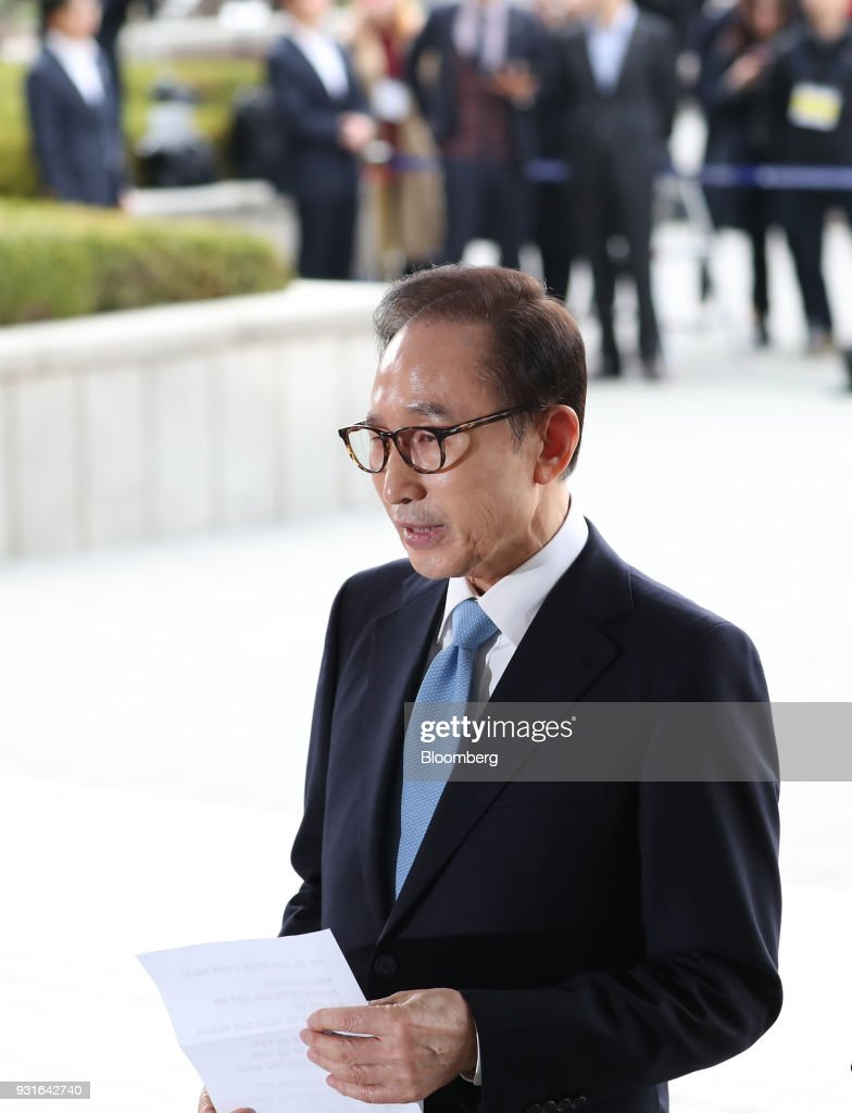Lee Myung-bak, South Korea's former president, speaks as he arrives at the Seoul Central District Prosecutors Office in Seoul, South Korea, on Wednesday, March 14, 2018. Lee apologized for 'causing concern' after arriving at the prosecutors office. Photographer: SeongJoon Cho/Bloomberg via Getty Images