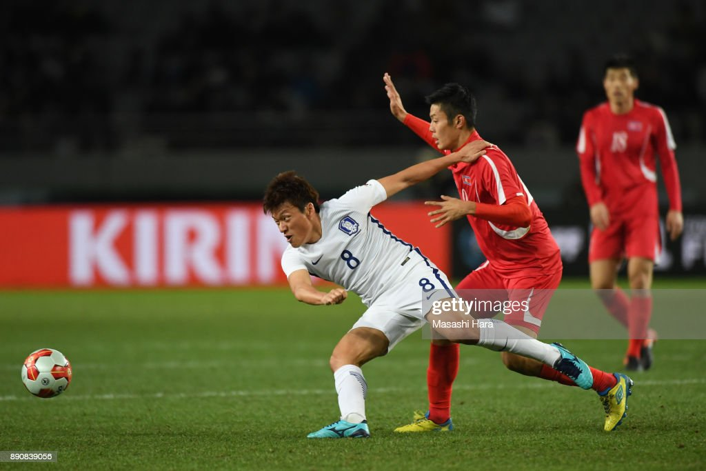 Lee Myungjoo of South Korea and An Byong Jun of North Korea compete for the ball during the EAFF E-1 Men's Football Championship between North Korea and South Korea at Ajinomoto Stadium on December 12, 2017 in Chofu, Tokyo, Japan.