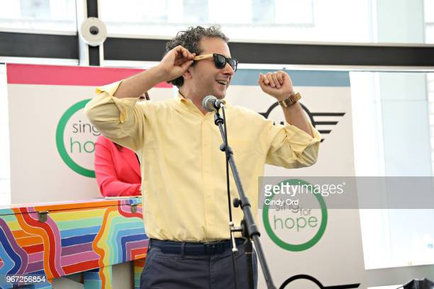 Lee Nadler Marketing Communications Launch Manager MINI USA speaks on stage as the 2018 Sing for Hope Pianos are unveiled at 28 Liberty on June 4...