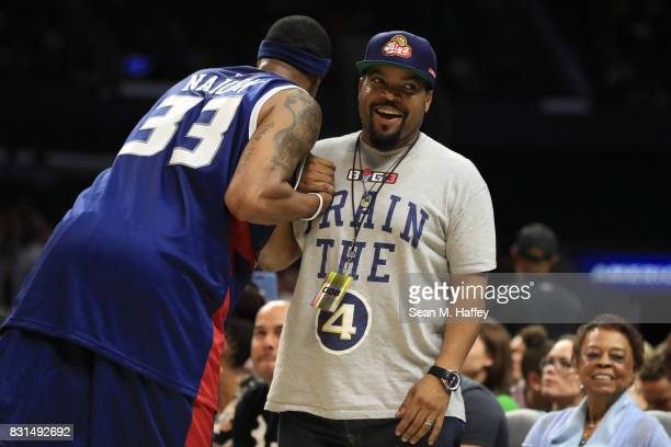 Lee Nailon of the TriState greets BIG3 founder and recording artist Ice Cube during week eight of the BIG3 three on three basketball league at...
