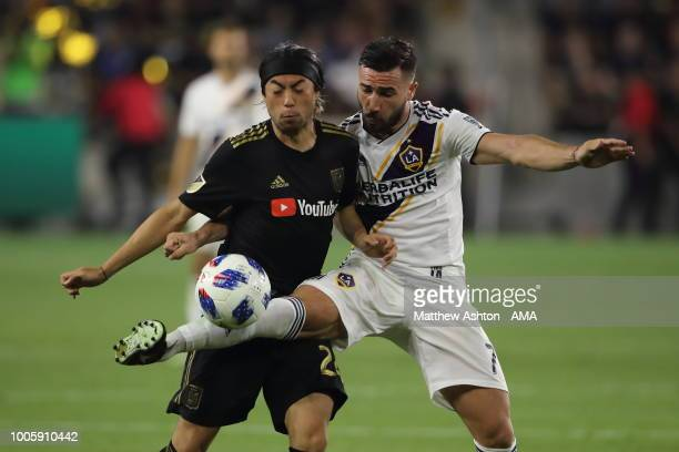 Lee Nguyen of LAFC Los Angeles Football Club and Romain Alessandrini of LA Galaxy during the MLS match between LAFC and LA Galaxy at Banc of...