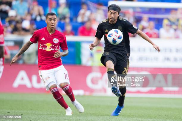 Lee Nguyen of Los Angeles FC challenged by Alejandro Romero Gamarra of New York Red Bulls during the New York Red Bulls Vs Los Angeles FC MLS regular...