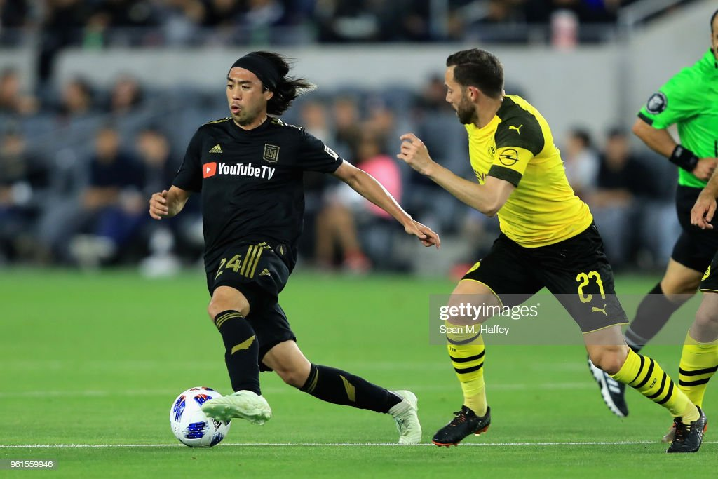 Lee Nguyen #24 of Los Angeles FC dribbles past Gonzalo Castro #27 of Borussia Dortmund during the second half of an International friendly soccer match at Banc of California Stadium on May 22, 2018 in Los Angeles, California.