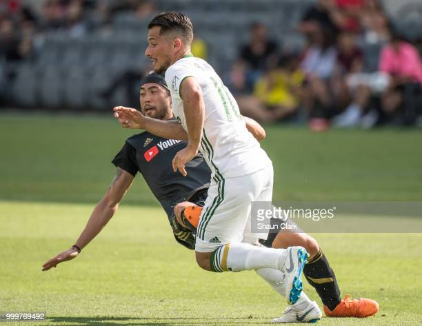 Lee Nguyen of Los Angeles FC fouls Andy Polo of Portland Timbers and was given a red card at the Banc of California Stadium on July 15 2018 in Los...