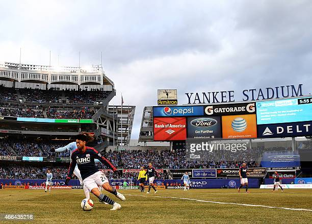 Lee Nguyen of New England Revolution tries to keep the ball from Mix Diskerud of New York City FC during the inaugural game of the New York City FC...