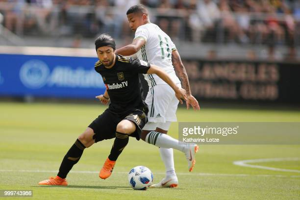 Lee Nguyen of the Los Angeles Football Club and Andy Polo of the Portland Timbers fight for control of the ball at Banc of California Stadium on July...