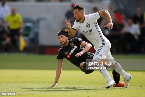 Lee Nguyen of the Los Angeles Football Club and Sebastian Blanco of the Portland Timbers battle for control of the ball at Banc of California Stadium...