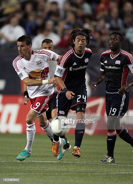 Lee Nguyen of the New England Revolution keeps the ball away from Sebastien Le Toux of the New York Red Bulls at Gillette Stadium September 22 2012...