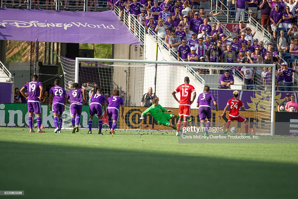 Lee Nguyen #24 of the New England Revolution scores penalty kick against the Orlando City Lions at the Citrus Bowl in Orlando, Florida on April 17, 2016.