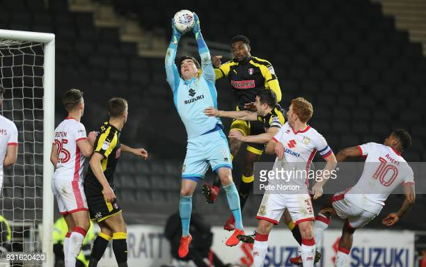 Lee Nicholls of Milton Keynes Dons collects the ball under pressure from Semi Ajayi of Rotherham United during the Sky Bet League One match between...