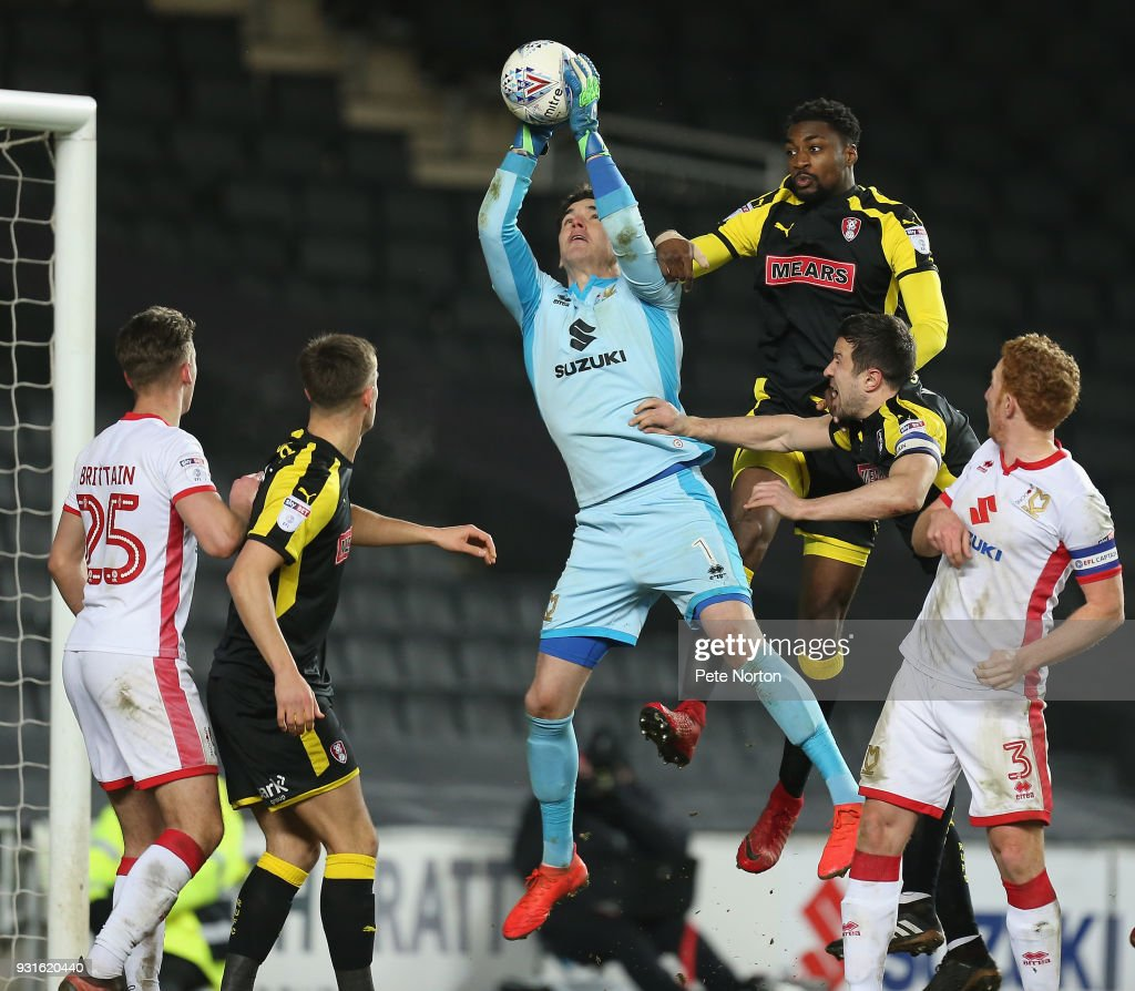 Lee Nicholls of Milton Keynes Dons collects the ball under pressure from Semi Ajayi of Rotherham United during the Sky Bet League One match between Milton Keynes Dons and Rotherham United at StadiumMK on March 13, 2018 in Milton Keynes, England.