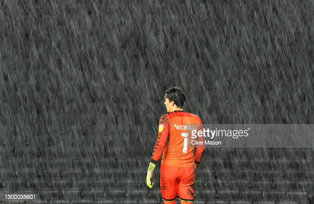 Lee Nicholls of MK Dons looks on as the rain falls during the Papa Johns Trophy match between Milton Keynes Donsd and Sunderland on February 02, 2021...