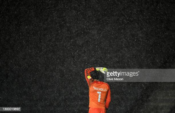 Lee Nicholls of MK Dons reacts as the rain falls during the Papa Johns Trophy match between Milton Keynes Donsd and Sunderland on February 02, 2021...