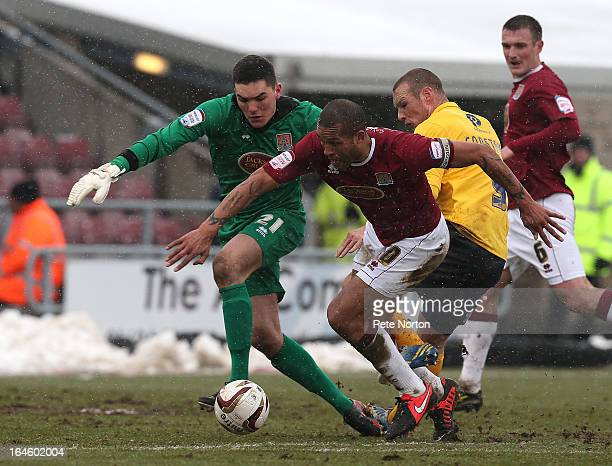 Lee Nicholls of Northampton Town and team mate Clarke Carlisle look for the ball with James Constable of Oxford United during the npower League Two...