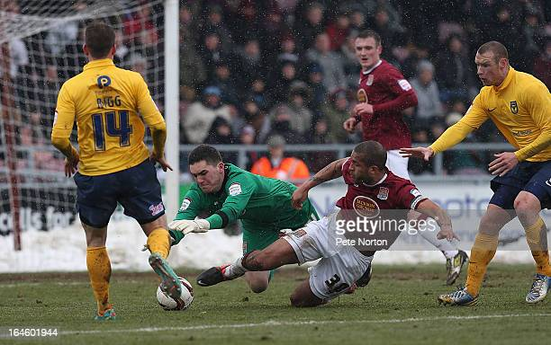Lee Nicholls of Northampton Town and team mate Clarke Carlisle attempt to control the ball as Sean Rigg and James Constable of Oxford United look on...