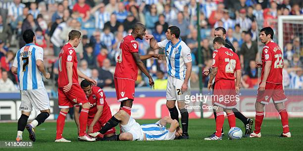 Lee Novak of Huddersfield argues with Leon Cort of Charlton after Darel Russell's tackle on Antony Kay during the npower League One match between...