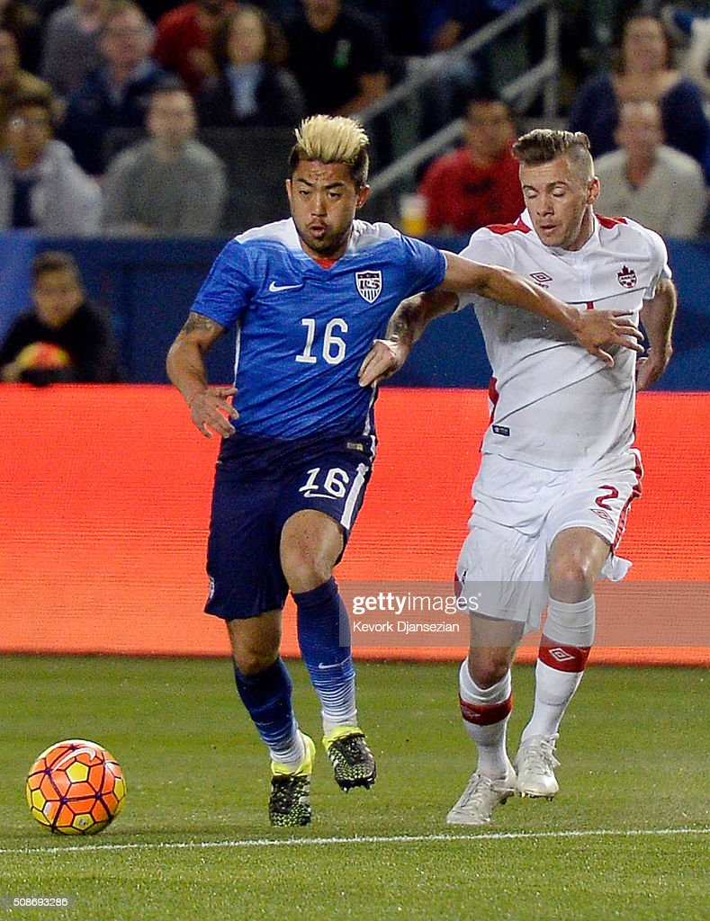 Lee Nugyen #16 of the United States dribbles and Nik Ledgerwood #2 of Canada battle for the ball during the first half of their international friendly soccer match at StubHub Center February 5, 2016, in Carson, California.