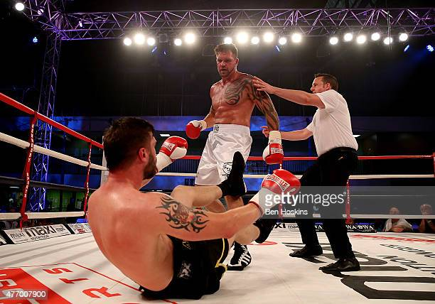 Lee Nutland of England knocks down Paul Morris of England exchange blows during their Cruiserweight bout at Action Indoor Sports Arena on June 13...