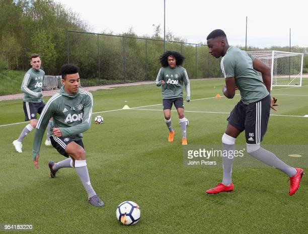Lee O'Connor Mason Greenwood Tahith Chong and Di'Shon Bernard of Manchester United U18s in action during an U18s training session at Aon Training...