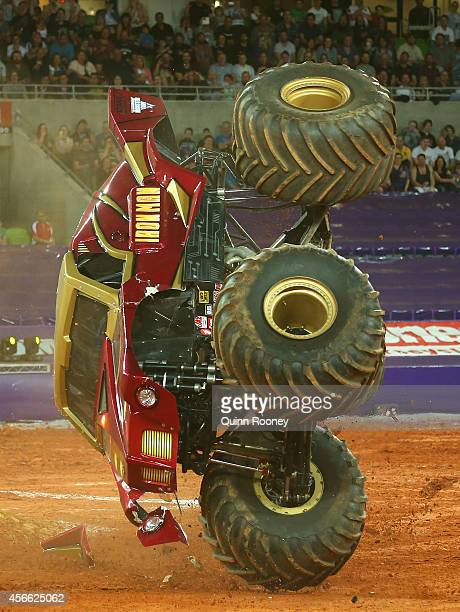Lee O'Donnell driving Iron Man crashes during Monster Jam at AAMI Park on October 4 2014 in Melbourne Australia