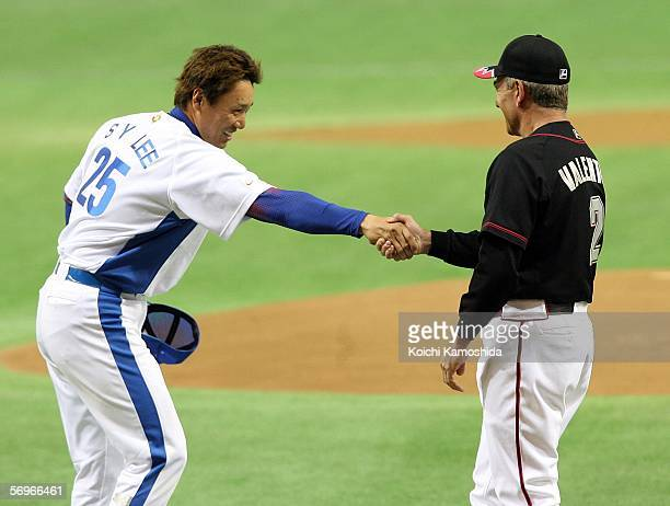 Lee of Korea shakes hands with team manager Bobby Valentine of the Chiba Lotte Marines during the 2006 World Baseball Classic Exhibition Game on...