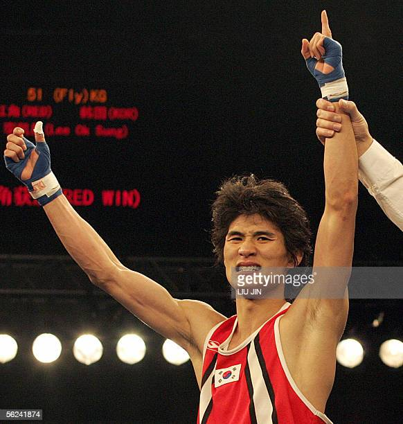 Lee Ok Sung of South korea celebrates his victory over Andry Lafita Hernandez of Cuba during their 51kg category final bout of the 13th World Senior...