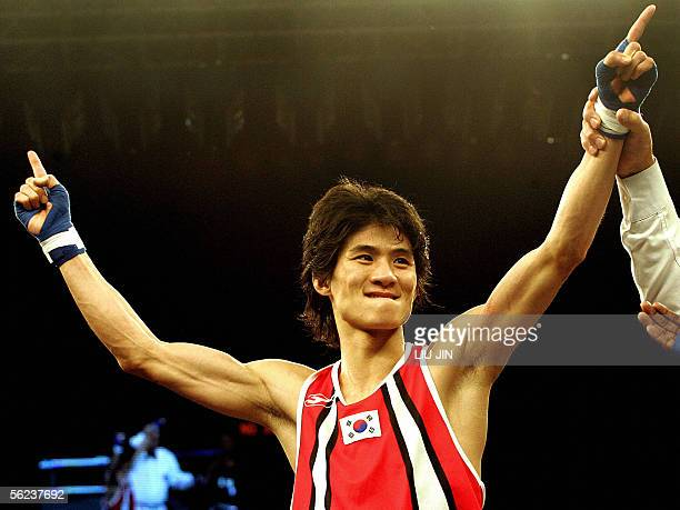 Lee Ok Sung of South Korea celebrates his victory over Rau'sShee Muhumad Warren of US during their 51kg category semifinal of the 13th World Senior...