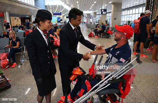 Lee Pearson of the Paralympics GB Team talks with members of the British Airways cabin crew prior to the flight back from Galeao Airport on British...