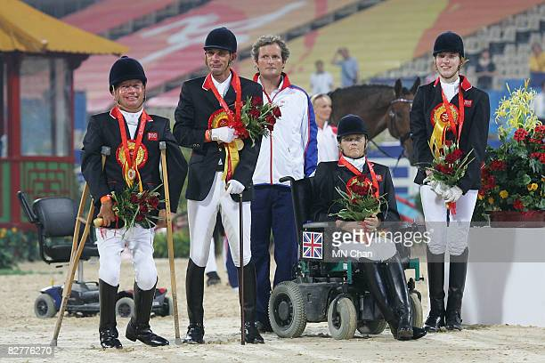 Lee Pearson Simon Laurens Anne Dunham and Sophie Christiansen of Great Britain celebrate after winning the Gold Medal of Overall Team at Hong Kong...