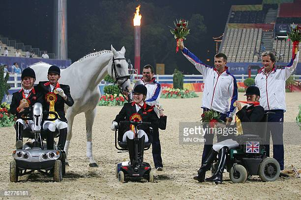 Lee Pearson Simon Laurens Sophie Christiansen and Anne Dunham of Great Britain celebrate after winning the Gold Medal of Overall Team at Hong Kong...