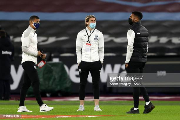 Lee Peltier, Conor Gallagher and Darnell Furlong of West Bromwich Albion inspect the pitch after arriving at the stadium ahead of the Premier League...