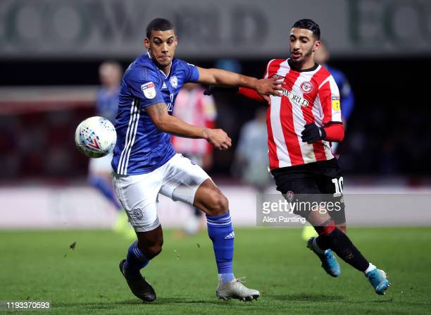 Lee Peltier of Cardiff City and Said Benrahma of Brentford battle for possession during the Sky Bet Championship match between Brentford and Cardiff...