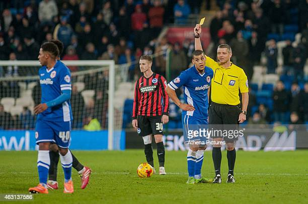 Lee Peltier of Cardiff City receives a yellow card from referee Iain Williamson during the Sky Bet Championship match between Cardiff City and...