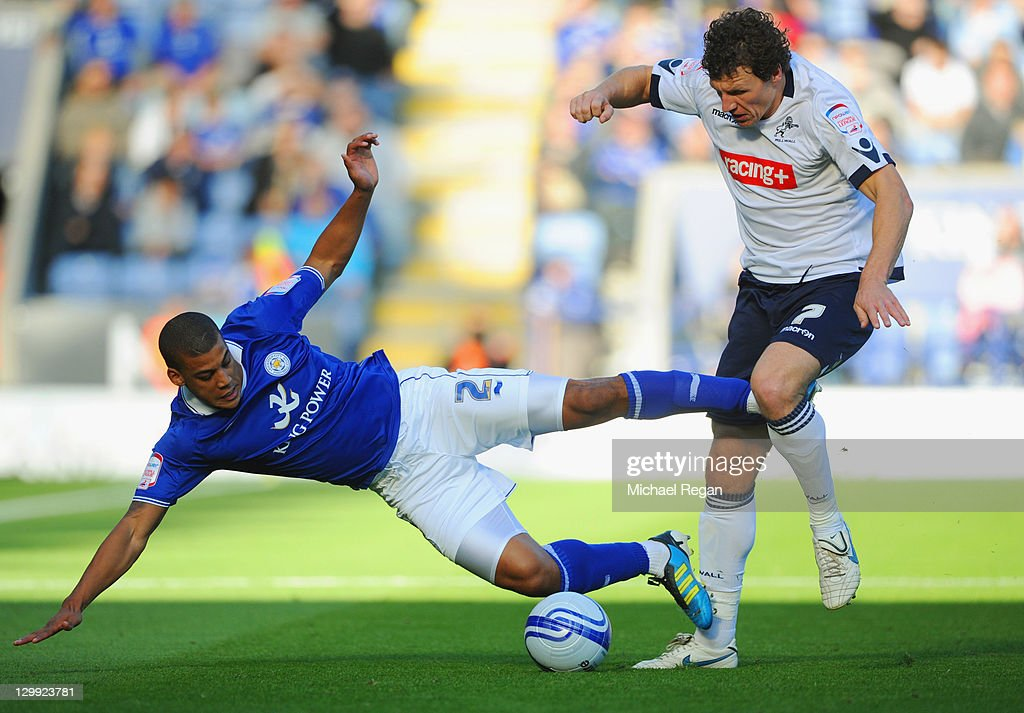 Lee Peltier of Leicester is fouled by Darius Henderson of Millwall during the npower Championship match between Leicester City and Millwall at the King Power Stadium on October 22, 2011 in Leicester, England.