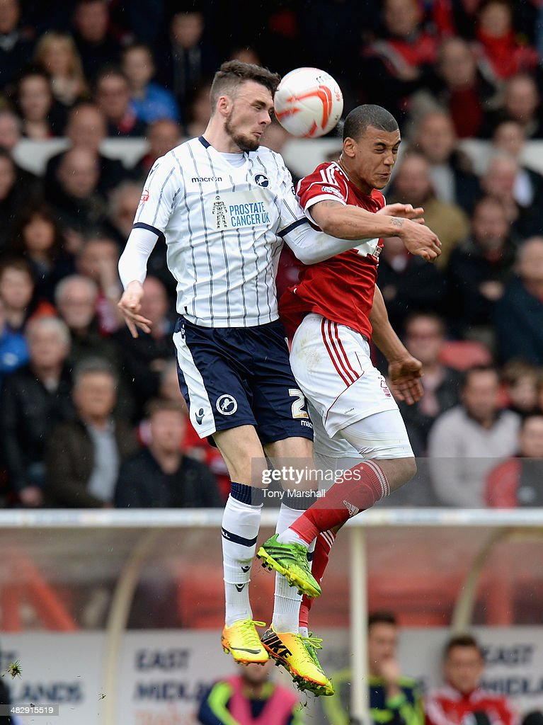 Lee Peltier of Nottingham Forest challenged by Scott Malone of Millwall during the Sky Bet Championship match between Nottingham Forest and Millwall at City Ground on April 05, 2014 in Nottingham, England,