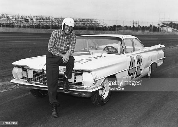 Lee Petty driver of the Oldsmobile poses in front of his car before the first 1959 Winston Cup Daytona 500 race at the Daytona International Speedway...