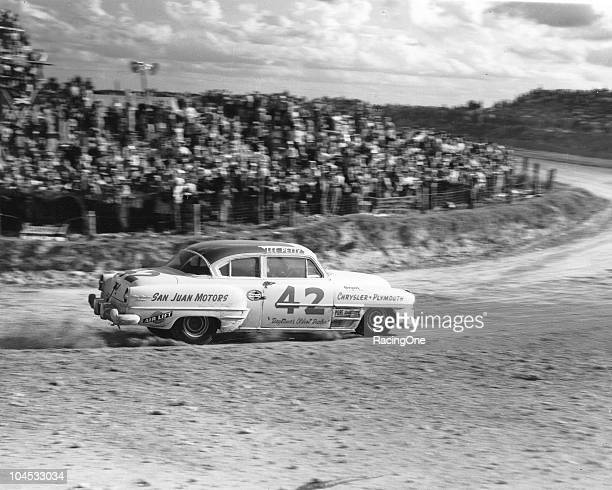 Lee Petty guides his Chrysler through a turn on his way to winning the NASCAR Cup race on the Daytona BeachRoad Course Petty dominated the event...