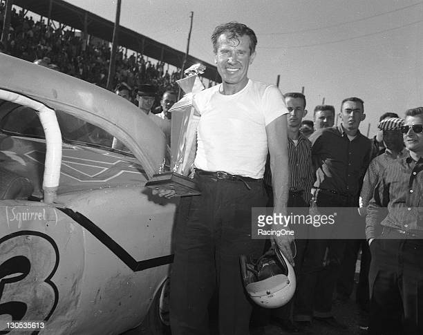 Lee Petty holds his trophy after driving his 1957 Oldsmobile to a win in the Gwyn Staley 160 NASCAR Cup race at North Wilkesboro Speedway
