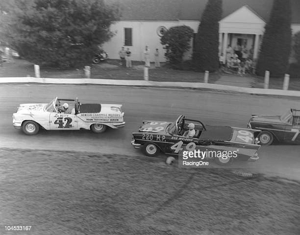 Lee Petty in an Oldsmobile leads Bob WelbornÕs Chevrolet and Larry FrankÕs Õ56 Chevrolet during a NASCAR Convertible Series race at BowmanGray...