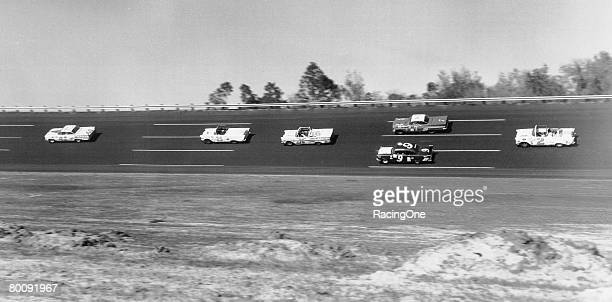 Lee Petty leads the 1959 Daytona 500 driving an Oldsmobile He came out the winner in a photo finish