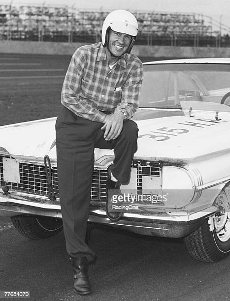 Lee Petty patriarch of the famous Petty racing dynasty relaxes on his 1959 Oldsmobile He became winner of the first Daytona 500