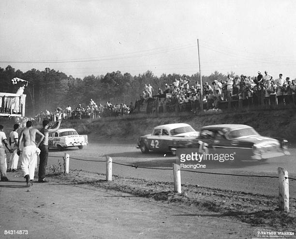 Lee Petty won the 200lap race at the dirt AshevilleWeaverville Speedway ahead of Jim Paschal Note Richard Petty cheering his father at the sidelines