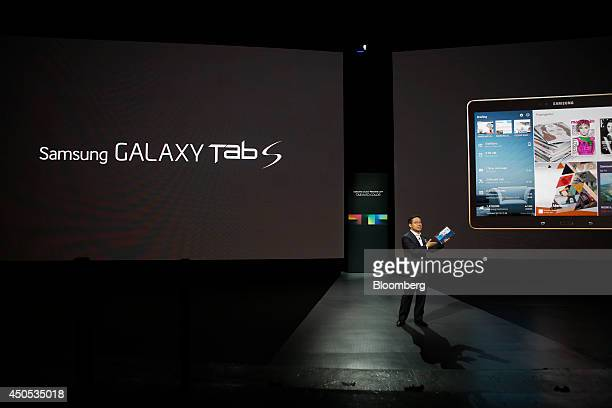 DJ Lee president of the IT Mobile Communications Division at Samsung Electronics Co unveils the Galaxy Tab S tablet computer during the Galaxy...