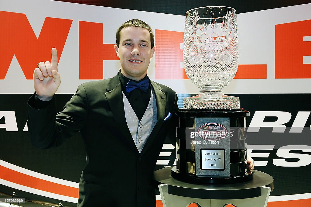Lee Pulliam poses with the champions trophy after the NASCAR Whelen All-American Series Awards in the Charlotte Convention Center at the NASCAR Hall of Fame on December 7, 2012 in Charlotte, North Carolina.