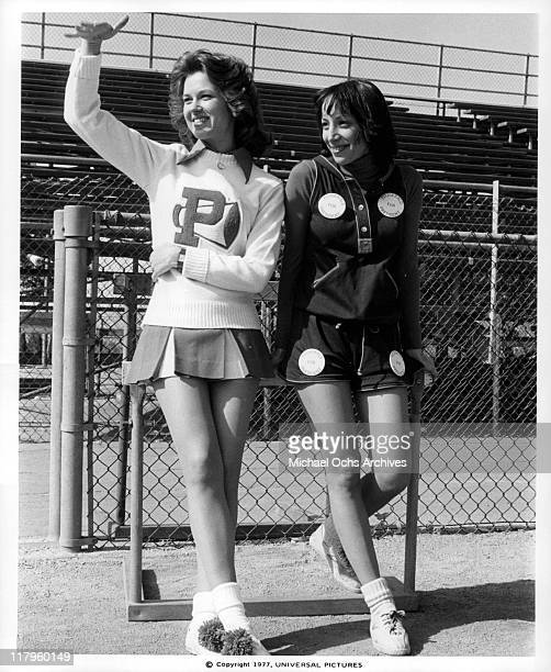 Lee Purcell gesturing while standing with Didi Conn in a scene from the film 'Almost Summer' 1978