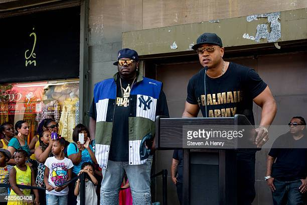 Lee 'Q' O'Denat and LL Cool J attend the 2015 BackToSchool Backpack Giveaway at Jamaica Colosseum Mall on August 30 2015 in New York City